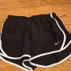 Black Nike running shorts